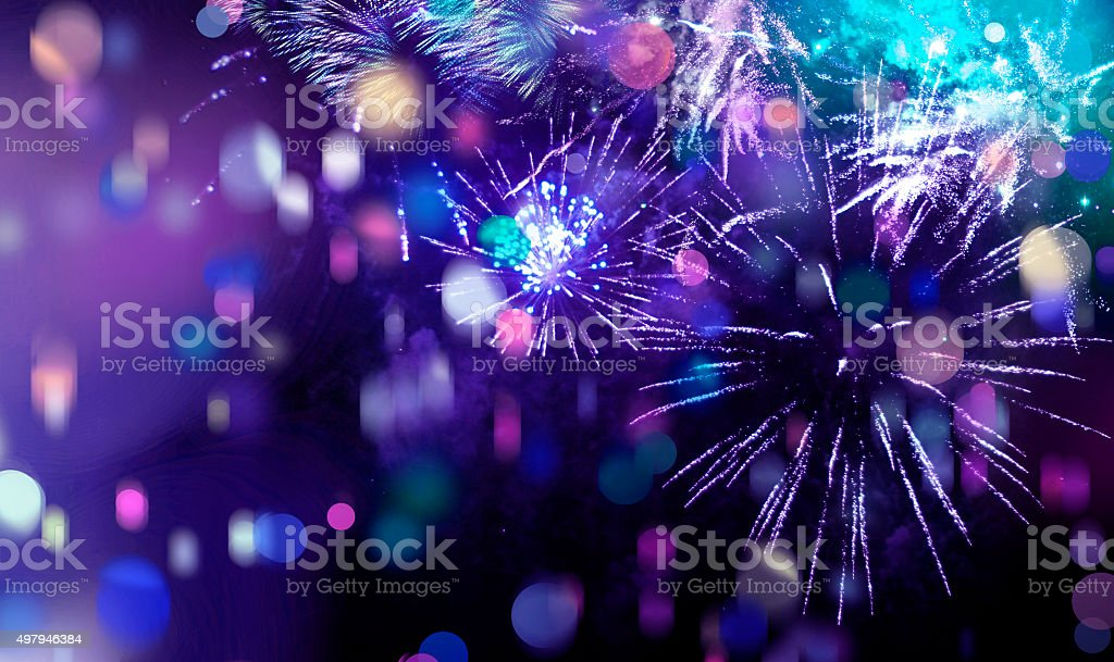bright sparkling multicolor fireworks and confetti stock photo