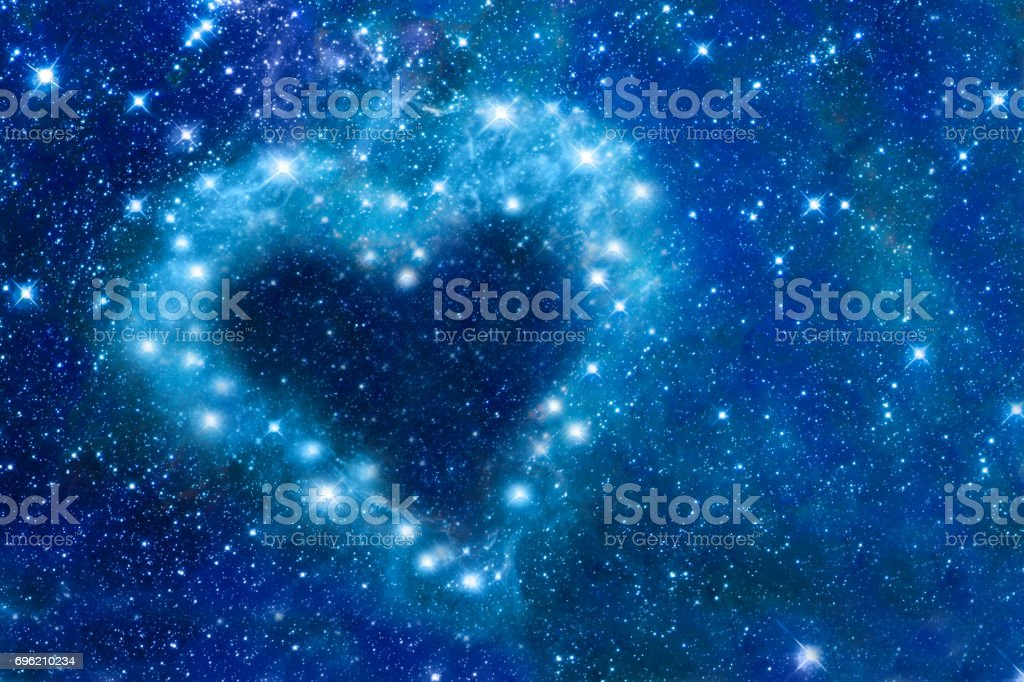 Bright stars in a night sky arranged in the shape of a heart,...