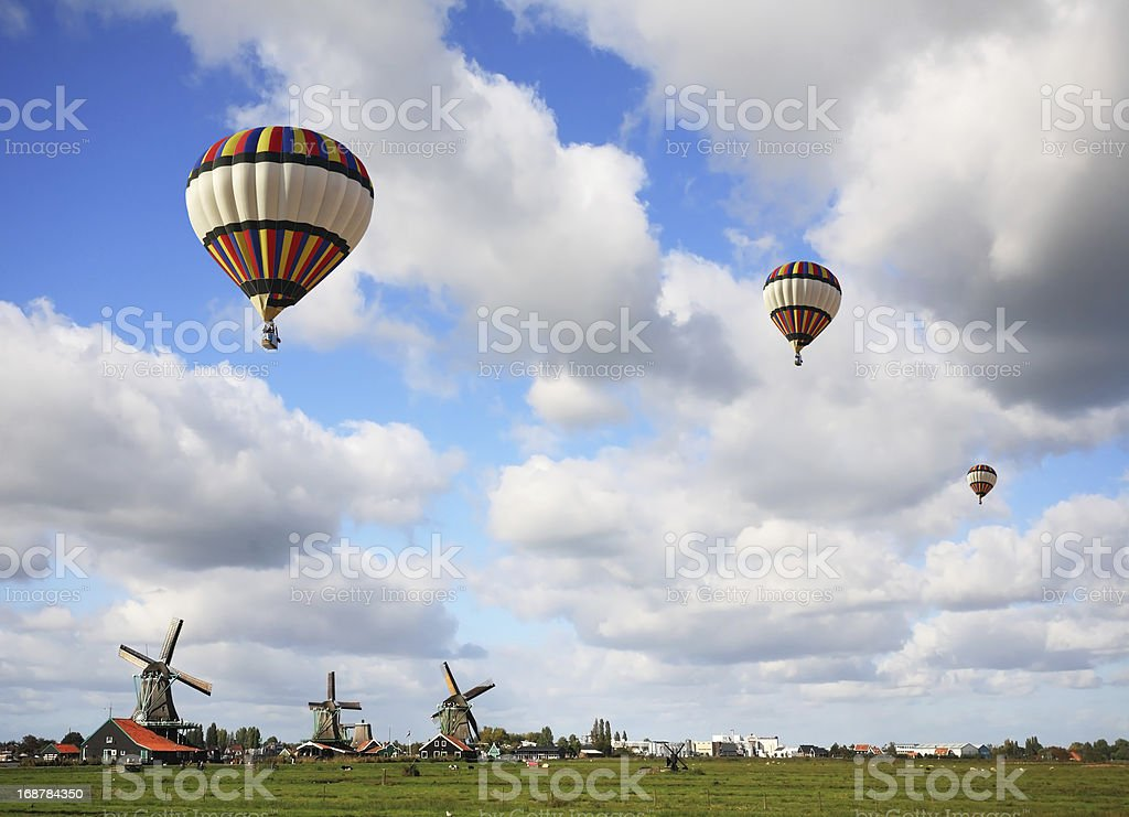 Bright striped balloon flies royalty-free stock photo