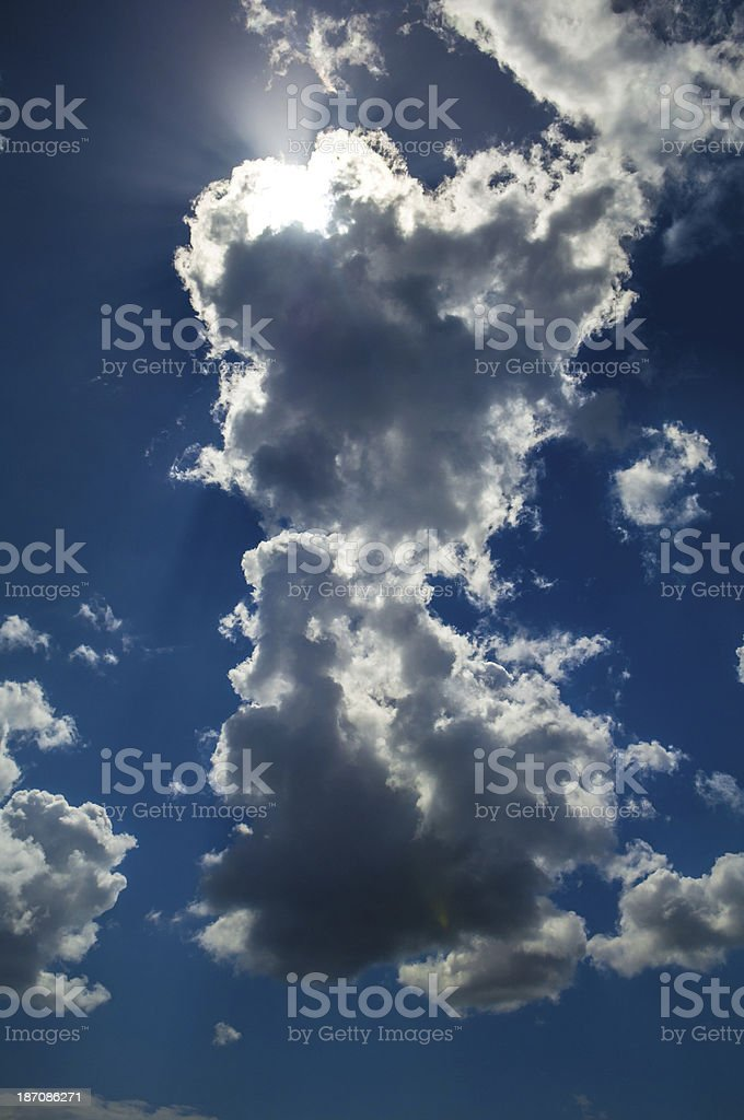 Bright sun behind clouds royalty-free stock photo