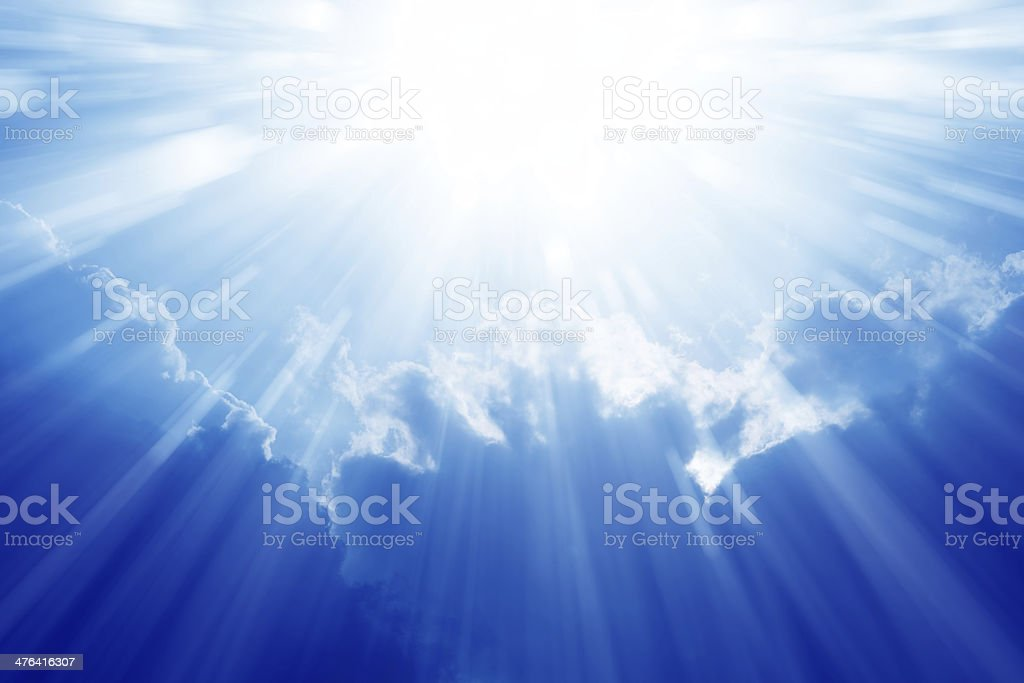 Bright sun, blue sky stock photo