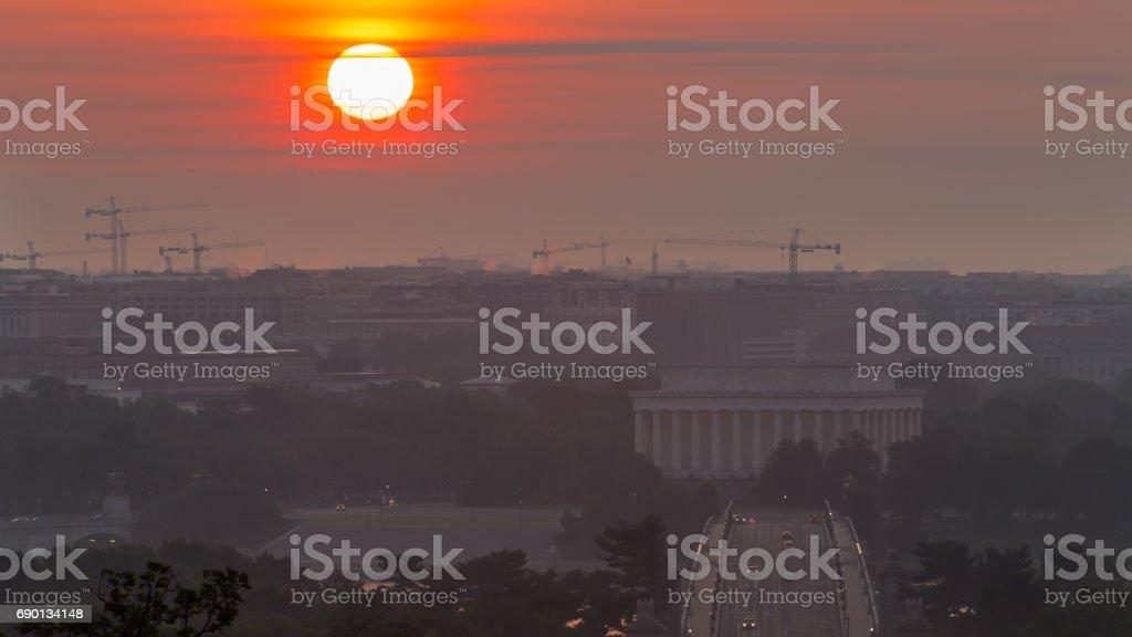 Bright sun on the horizon over the Washington, D.C. skyline stock photo