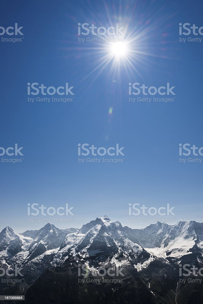 Bright sun over mountain peaks -XXXL royalty-free stock photo