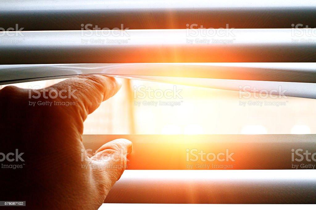 Bright sun shining through a jalousie stock photo