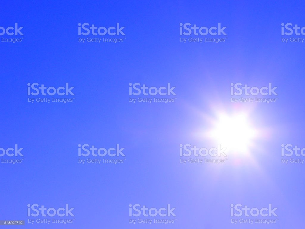 Bright sun with colorful beams stock photo