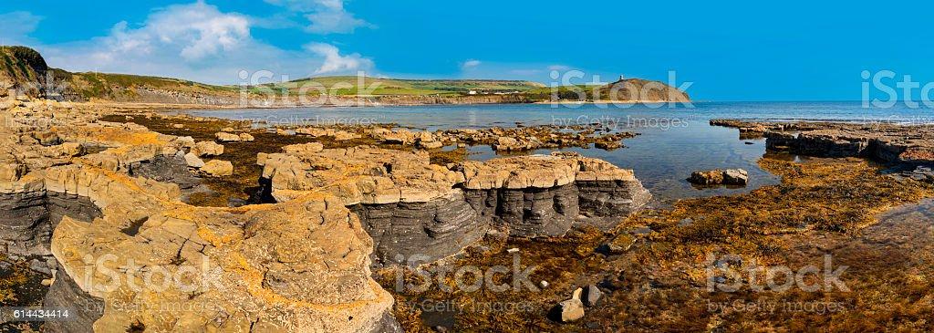 Bright sunlight illuminates sea, rocks and cliffs on Jurassic Coastline stock photo