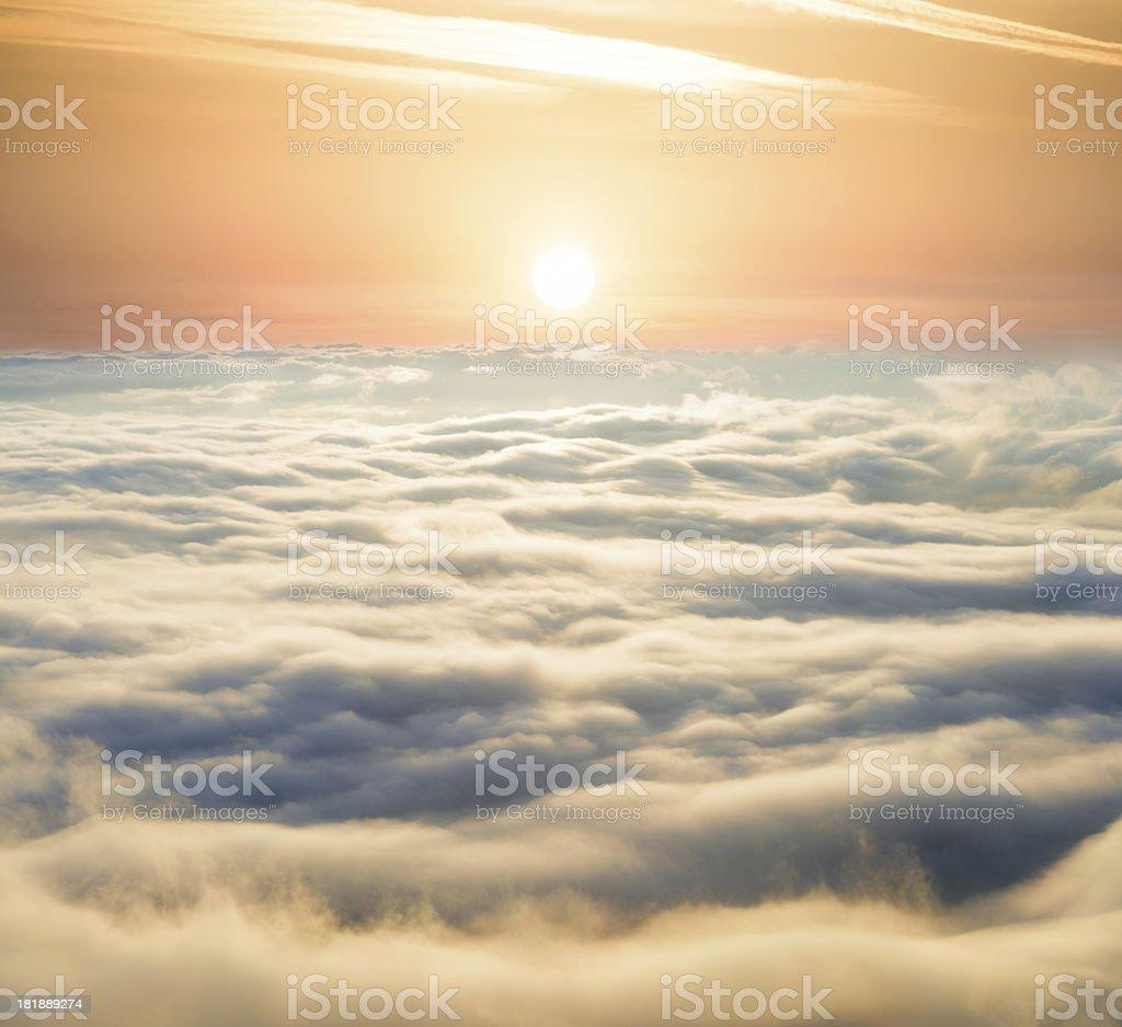 bright sunrise above clouds stock photo