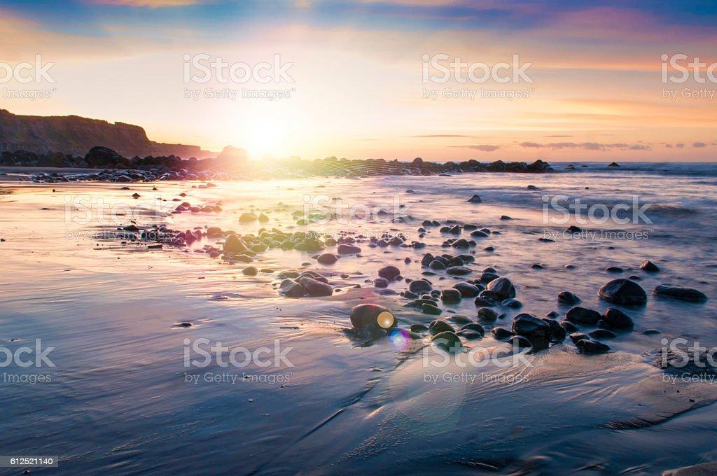 Bright sunrise with flare stock photo