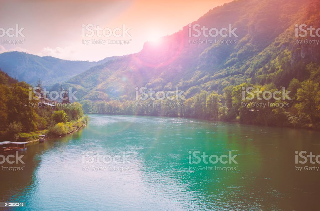 Bright sunset and beautiful river with reflections stock photo