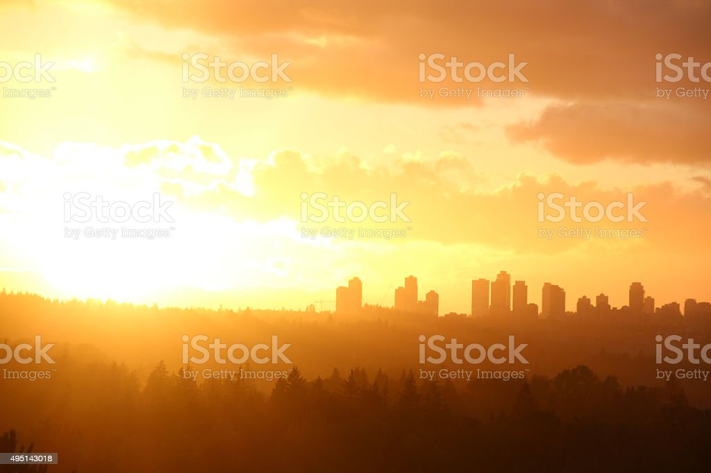 Bright sunset light in the sky stock photo