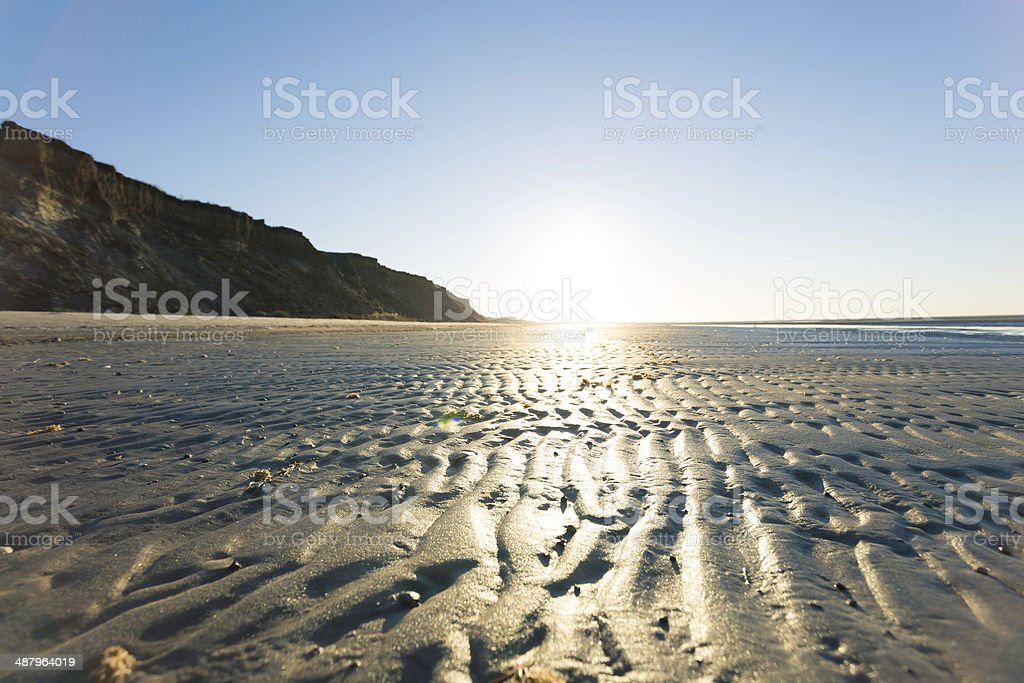 Bright sunset on a deserted beach royalty-free stock photo