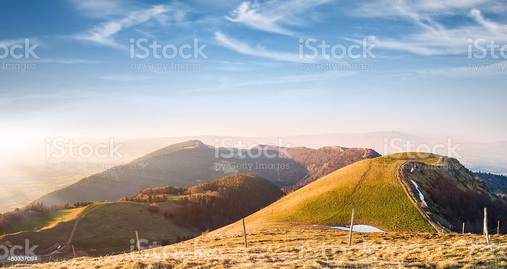 Bright sunset over majestic rolling landscape mountain scenic view stock photo