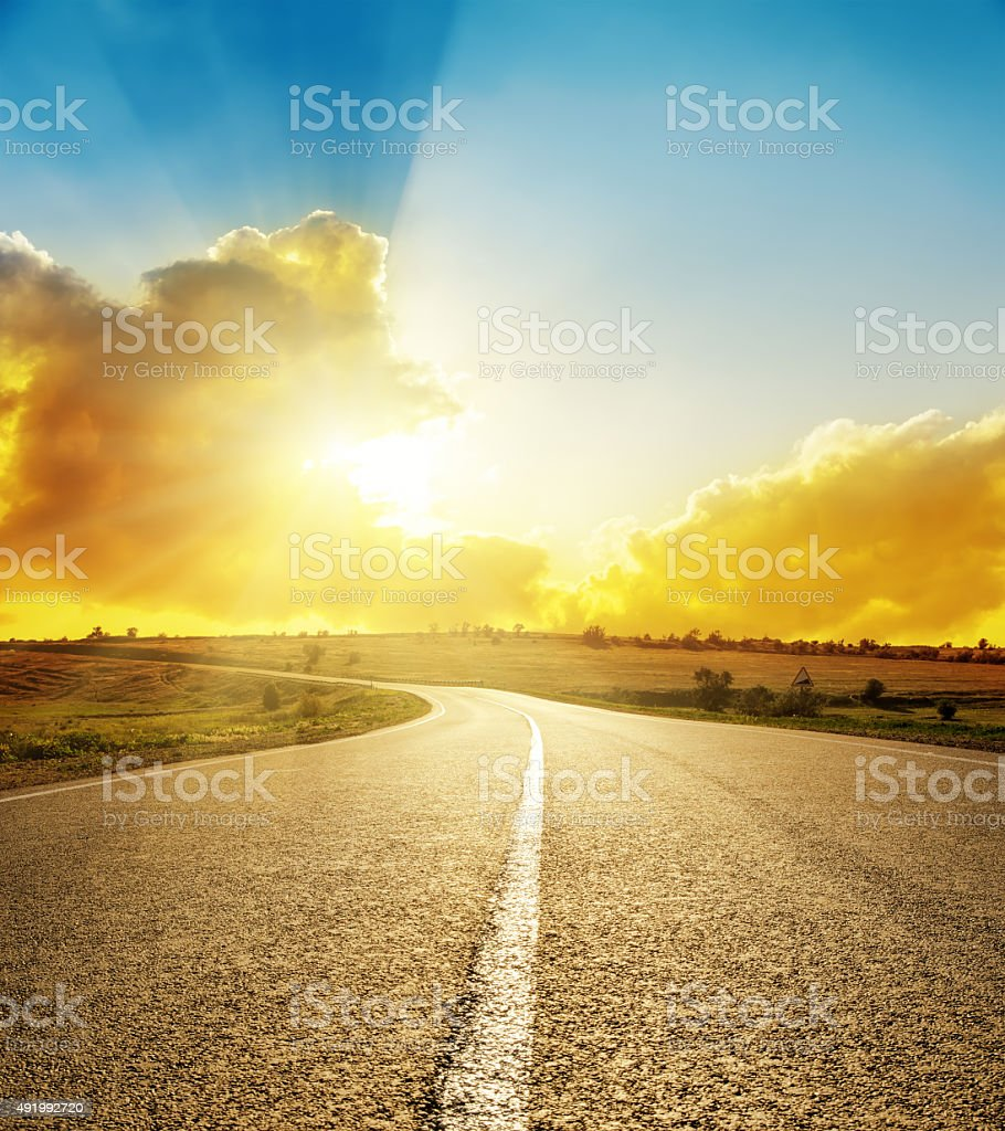 bright sunset over road stock photo