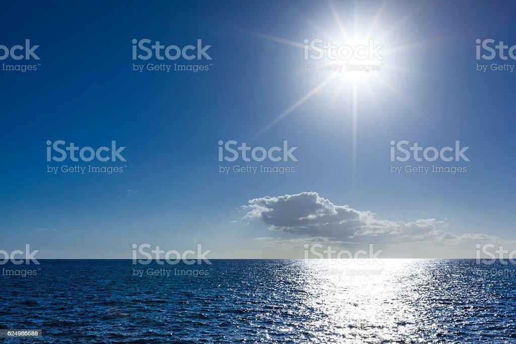 bright sunshine over water stock photo