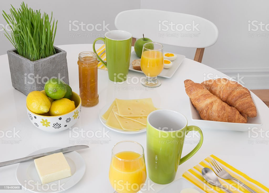 Bright table setting with tasty breakfast stock photo