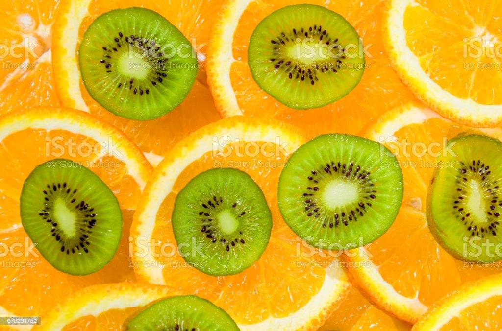 Bright tropical fruits. Orange and kiwi green. Fruit salad stock photo