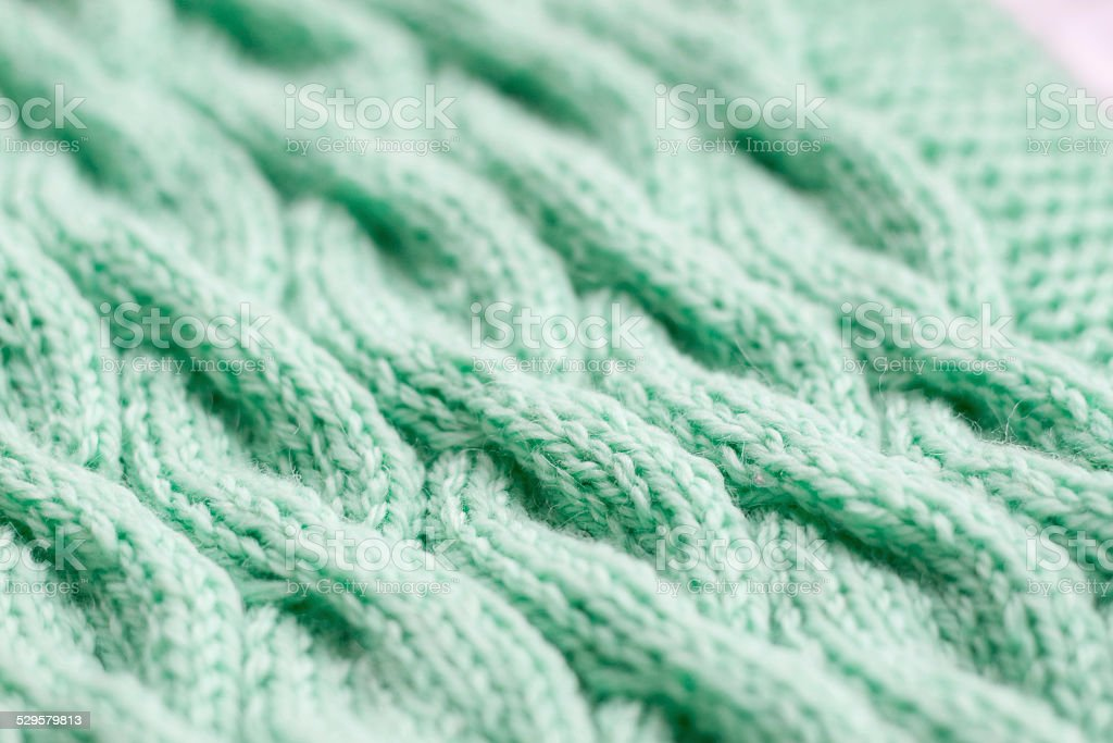 bright turquoise scarf hand-knitted stock photo