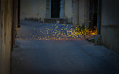 Bright Welding Sparks Fly Into Dark Alley