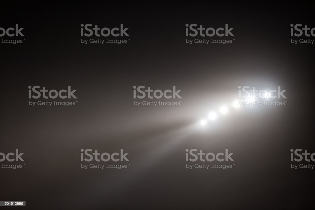 Bright white and yellow Stadium lights with fog stock photo