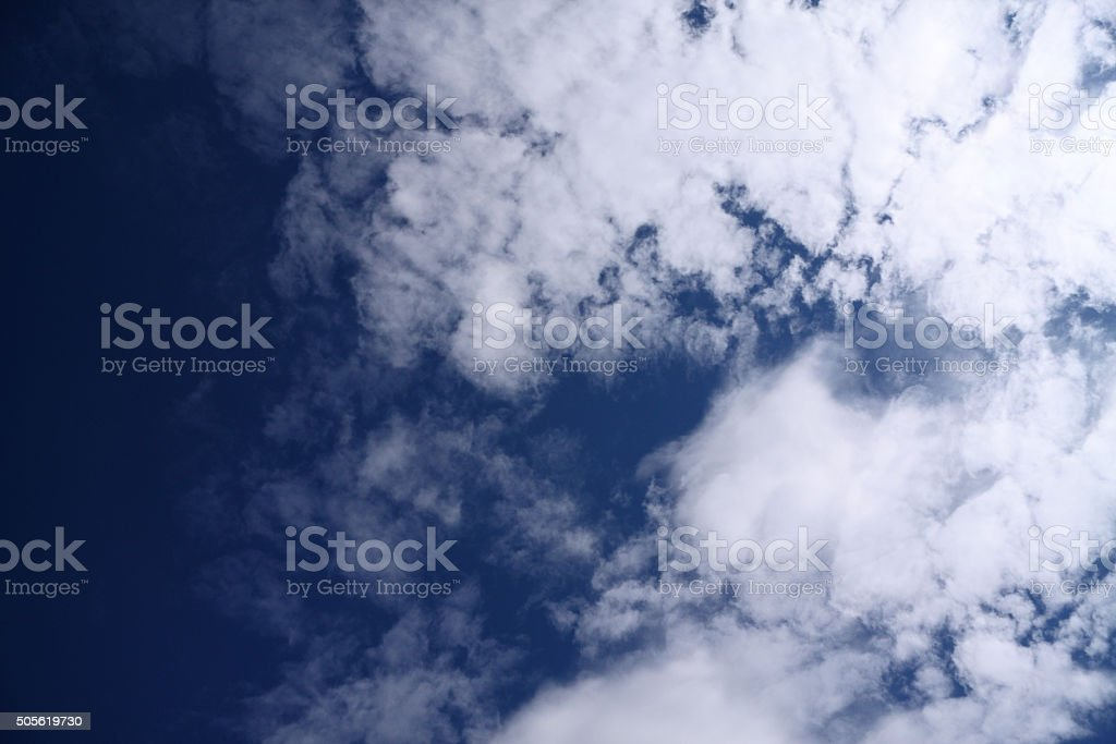 Bright white clouds in a blue sky stock photo