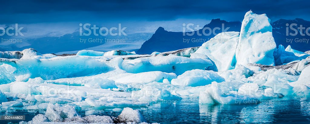Bright white icebergs creaking in blue lagoon glacier panorama Iceland stock photo