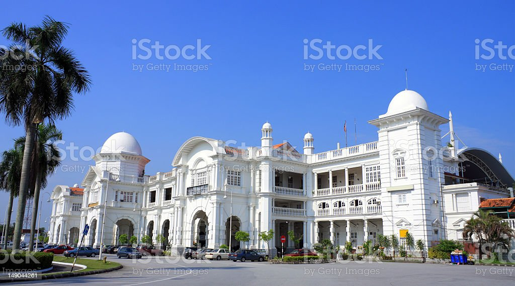 Bright white Ipoh railway station against blue sky stock photo