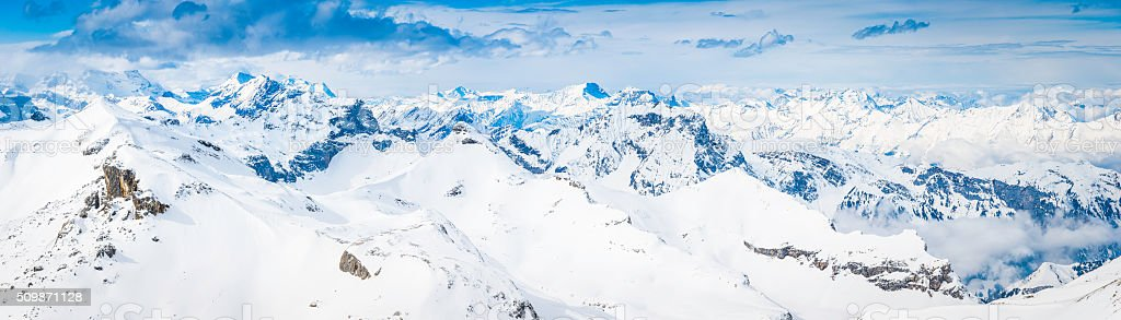 Bright white snowy mountain peaks aerial Alps panorama Switzerland stock photo