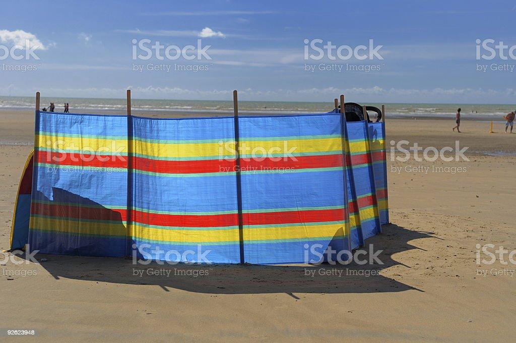 Bright windbreak on beach stock photo