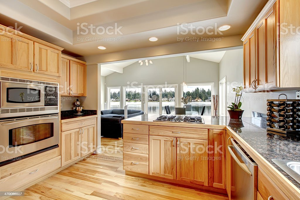 Bright wood kitchen and dining area stock photo