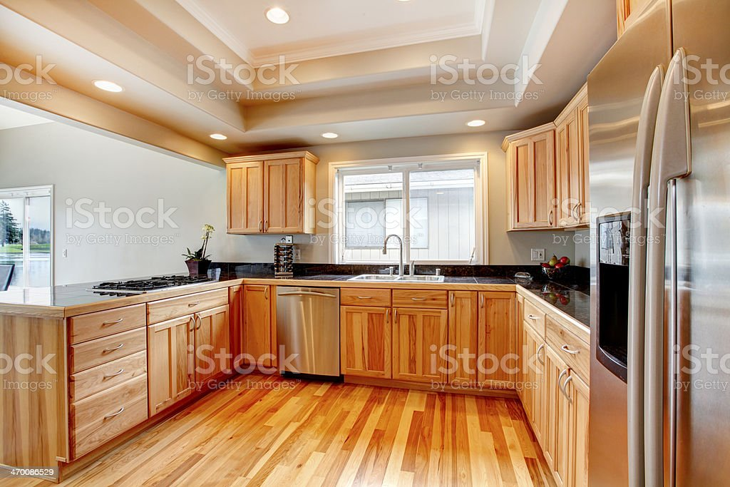 Bright wood kitchen with coffered ceiling stock photo