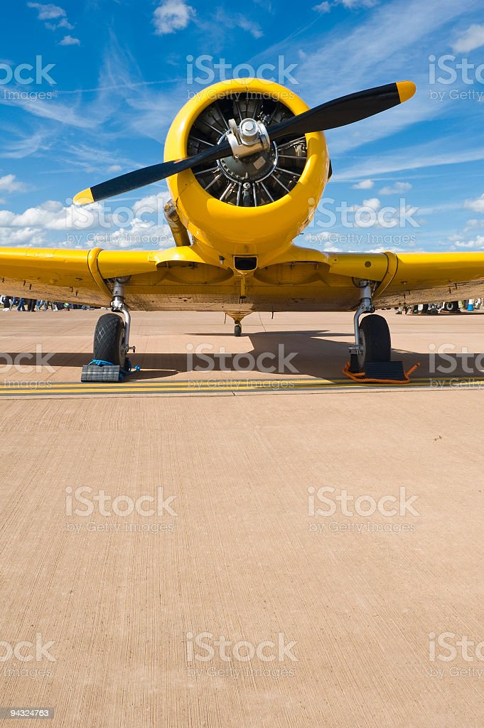 Bright yellow plane royalty-free stock photo
