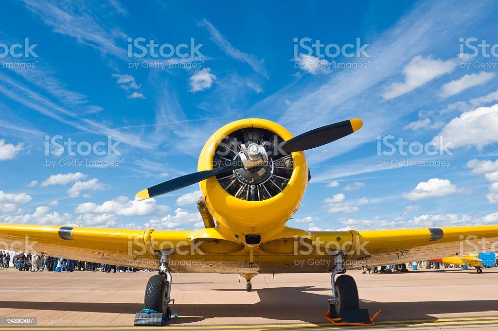 Bright yellow propellor aircraft stock photo