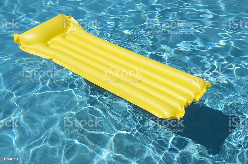 Bright Yellow Raft Floating in Empty Swimming Pool royalty-free stock photo