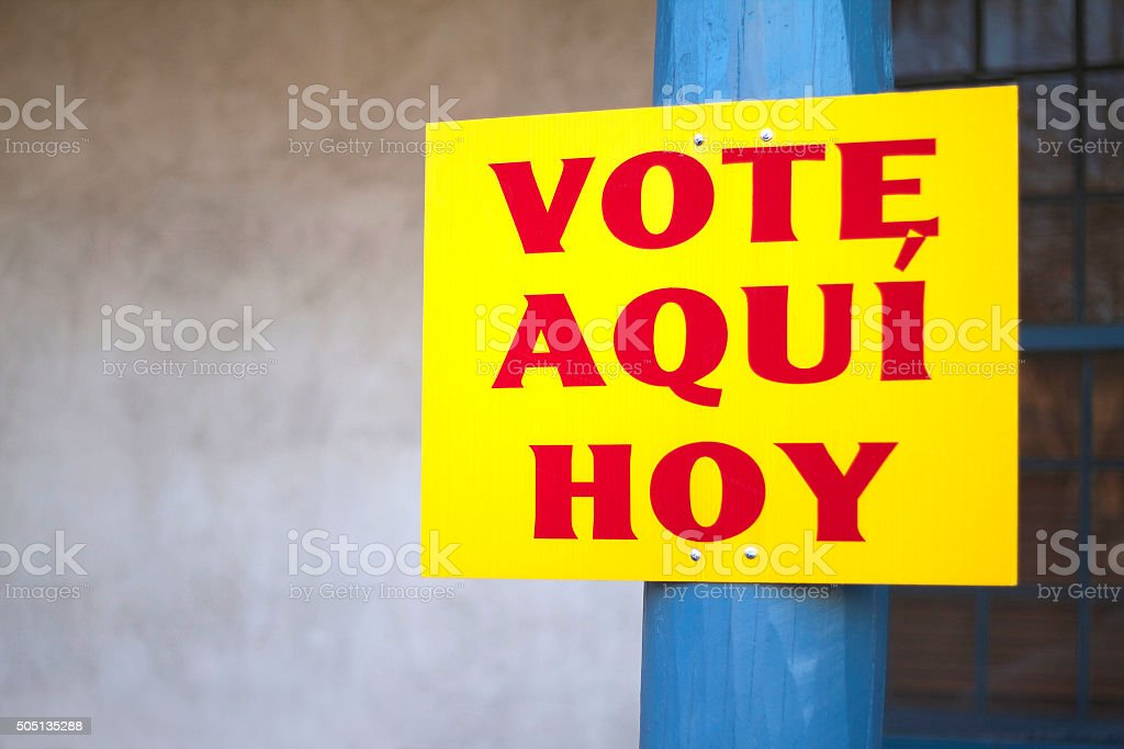 Bright Yellow Spanglish 'VOTE AQUI HOY' Sign stock photo