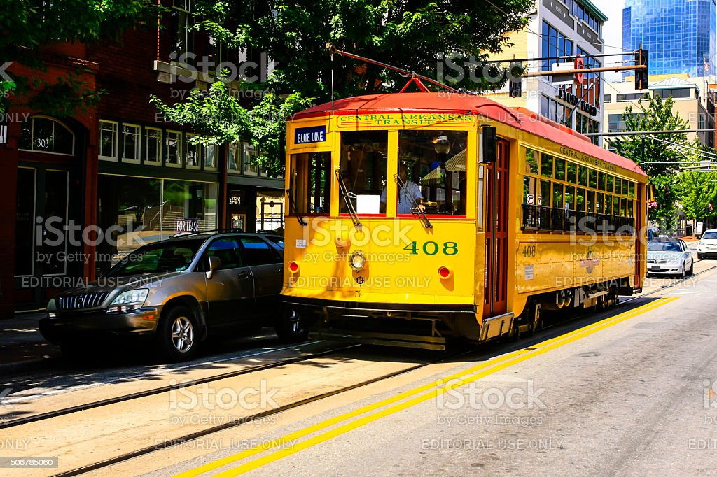 Bright yellow vintage city streetcars in downtown Little Rock Arkansas stock photo