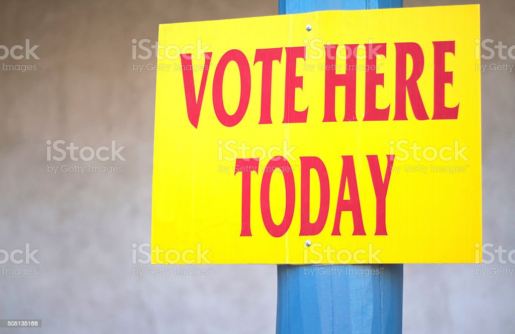 Bright Yellow 'VOTE HERE TODAY ' Sign stock photo