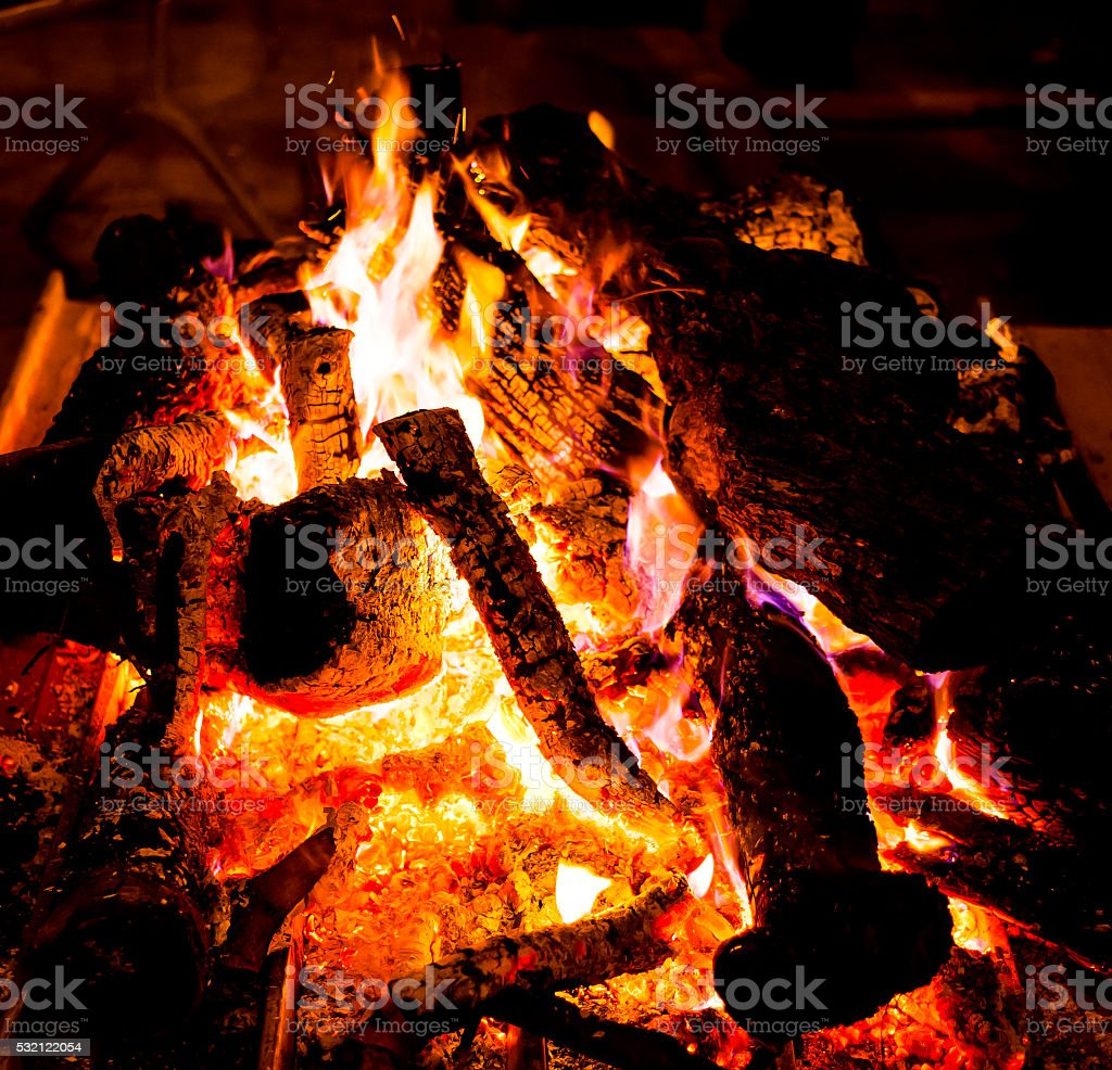 brightly are burning fire wood stock photo