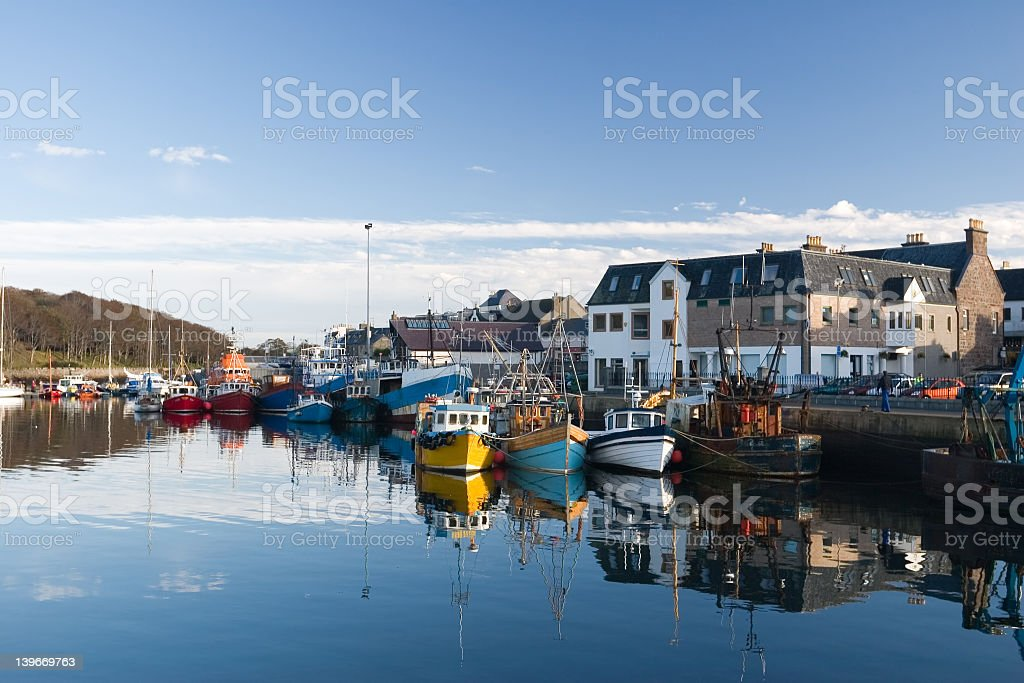 Brightly colored fishing boats in Stornoway Harbor stock photo