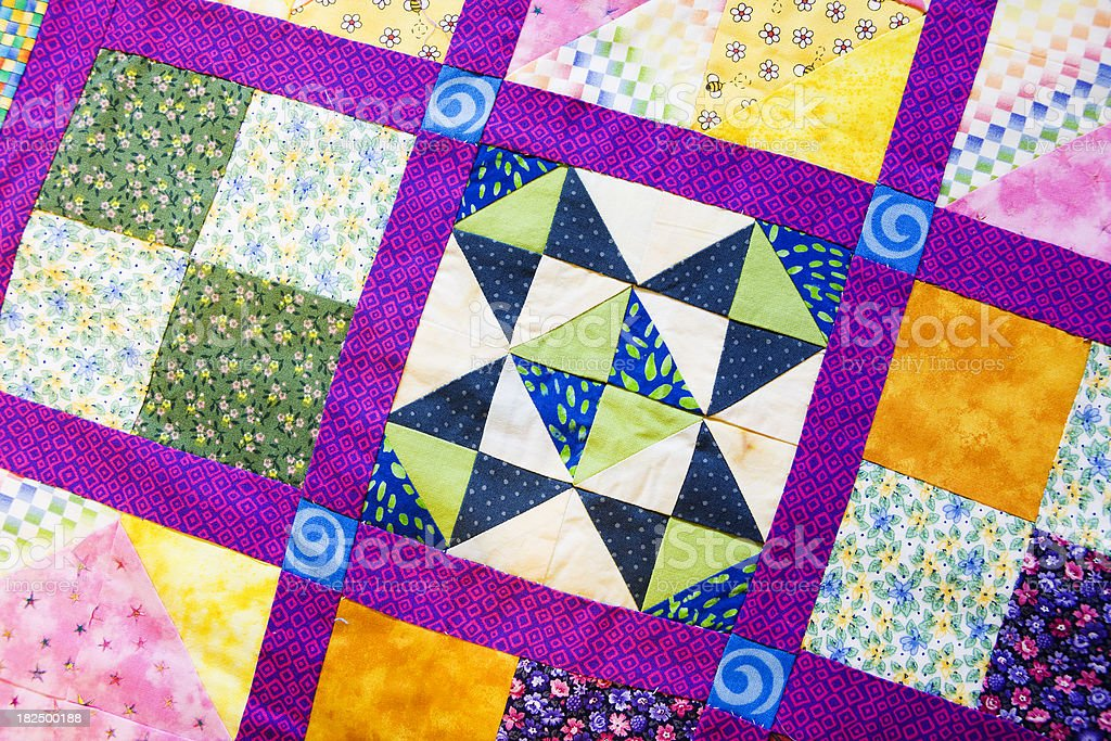 Brightly Colored Hand Pieced Quilt stock photo
