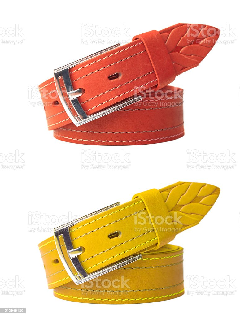 Brightly colored leather belts isolated stock photo