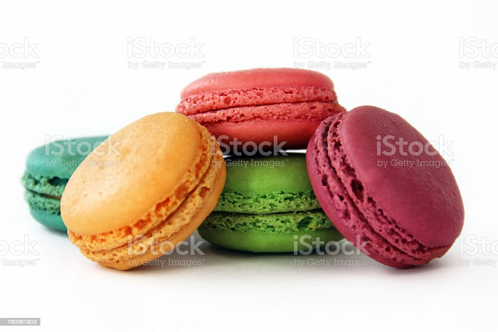 Brightly Colored Macarons on White Background stock photo