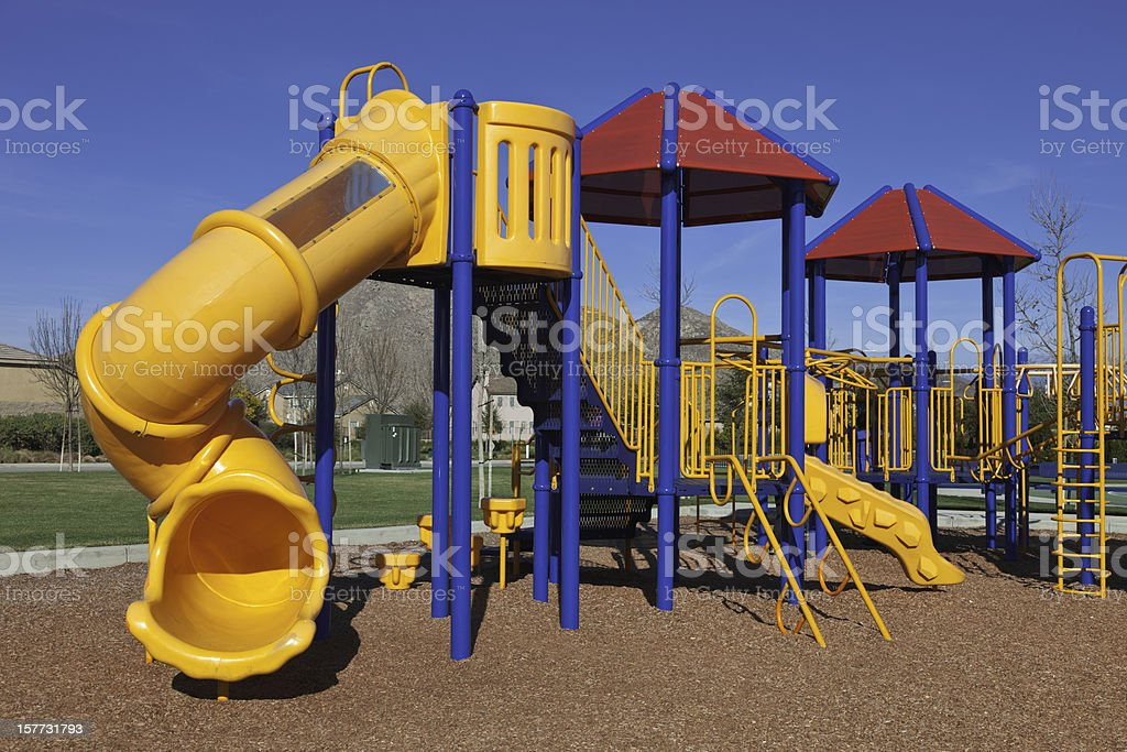 Brightly colored plastic playground in daytime royalty-free stock photo