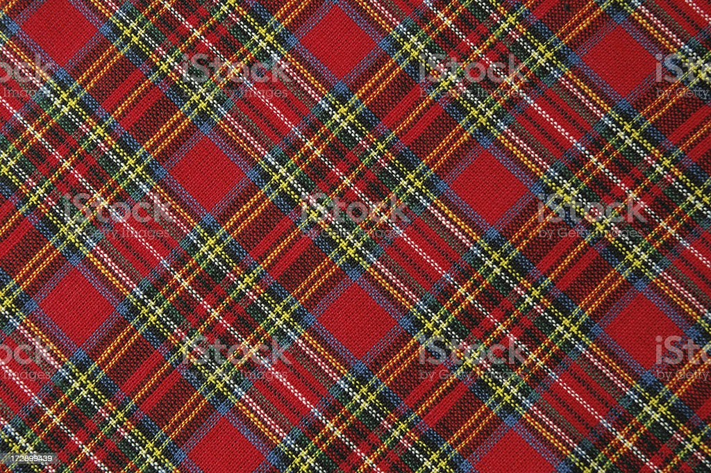 Brightly Colored Red Plaid Fabric Shot Diagonally stock photo