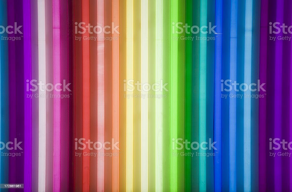 Brightly colored strips of neon rainbow stock photo