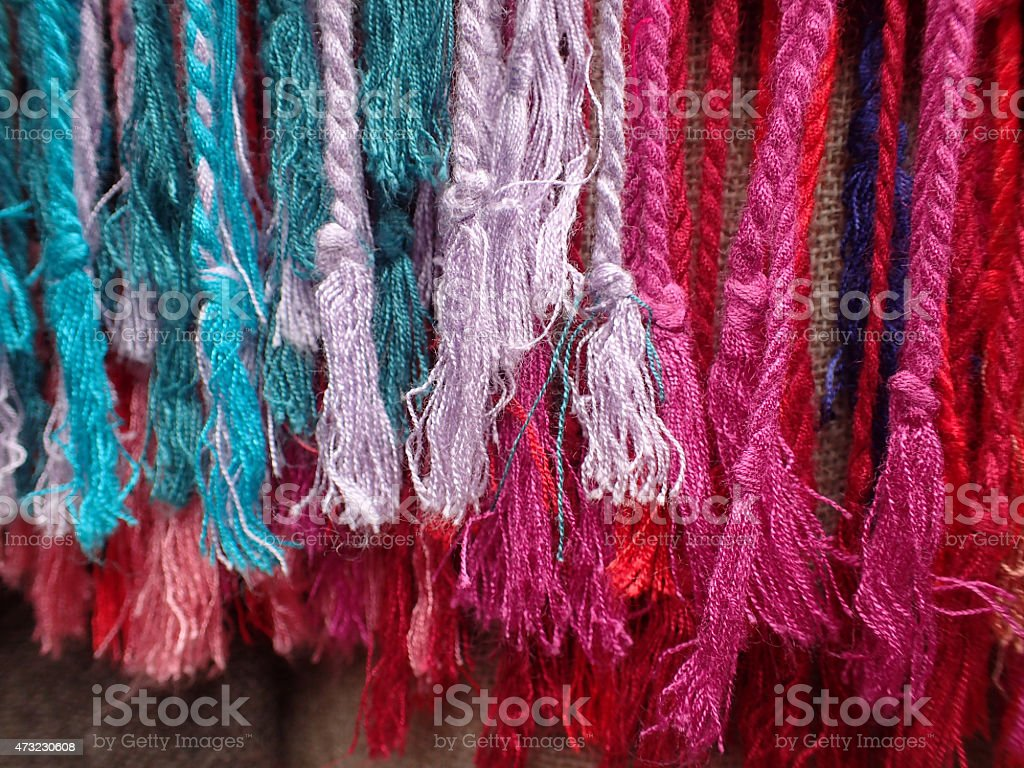 brightly colored tassles stock photo