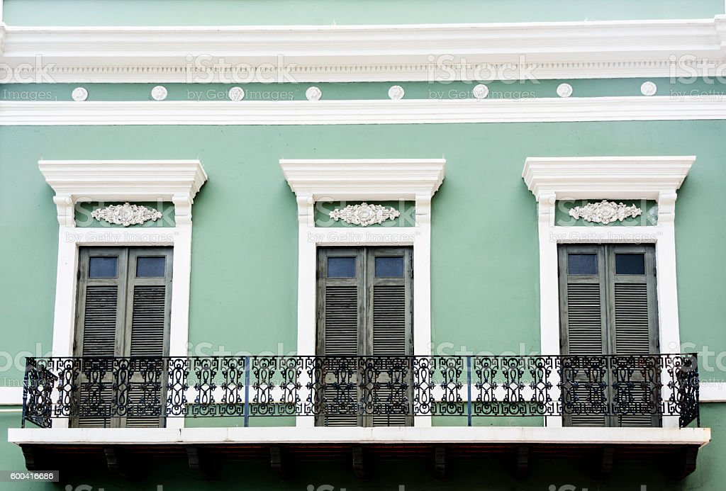 Brightly colored wall with balcony. Old San Juan, Puerto Rico. stock photo