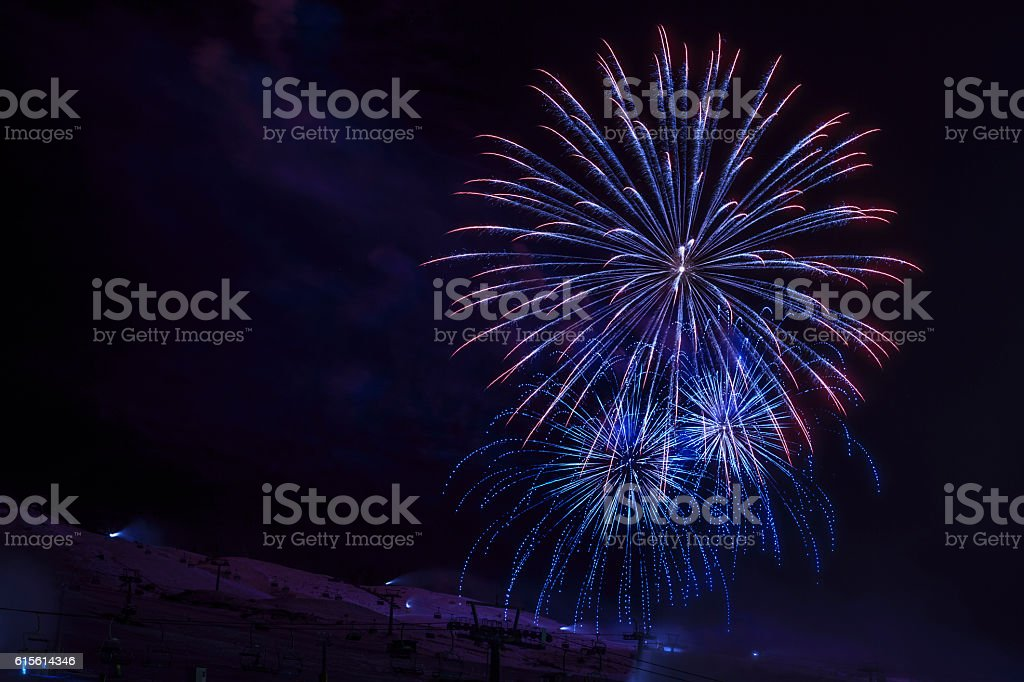 Brightly colorful fireworks   High mountain winter landscape   Night skiing stock photo