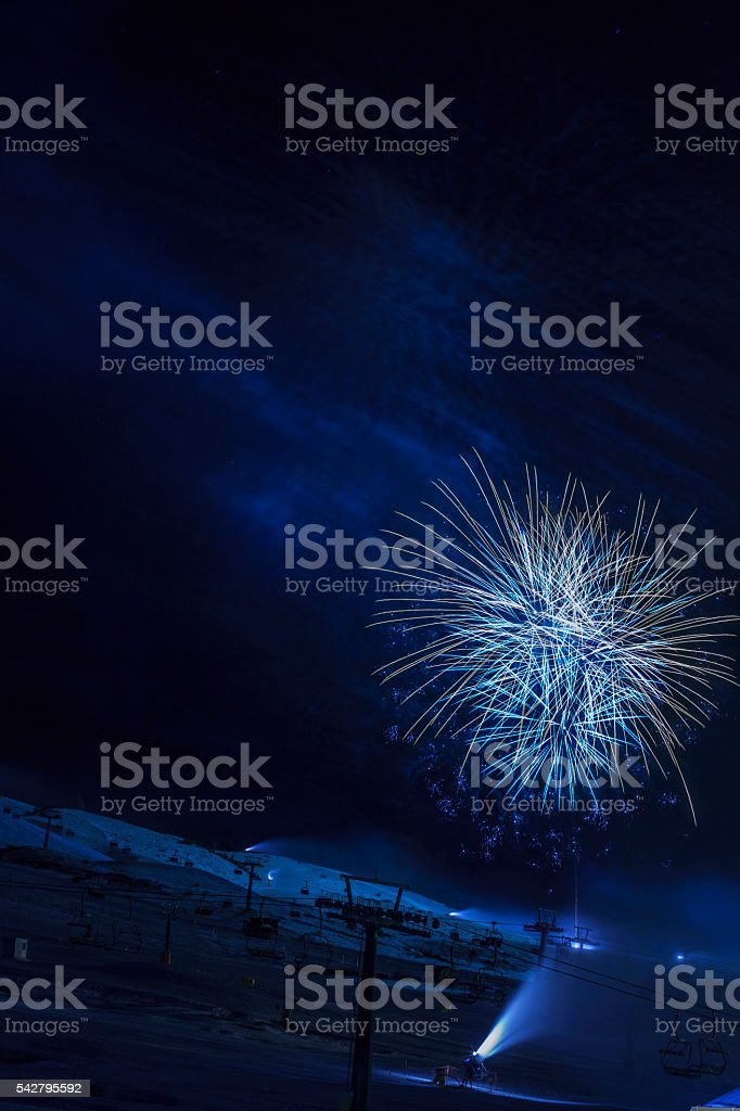Brightly colorful fireworks   High mountain winter landscape   Passo Tonale  Glacier stock photo