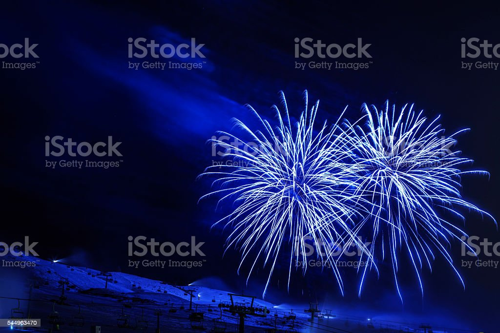 Brightly colorful fireworks   High mountain winter landscape   Passo Tonale  Glacier stock photo