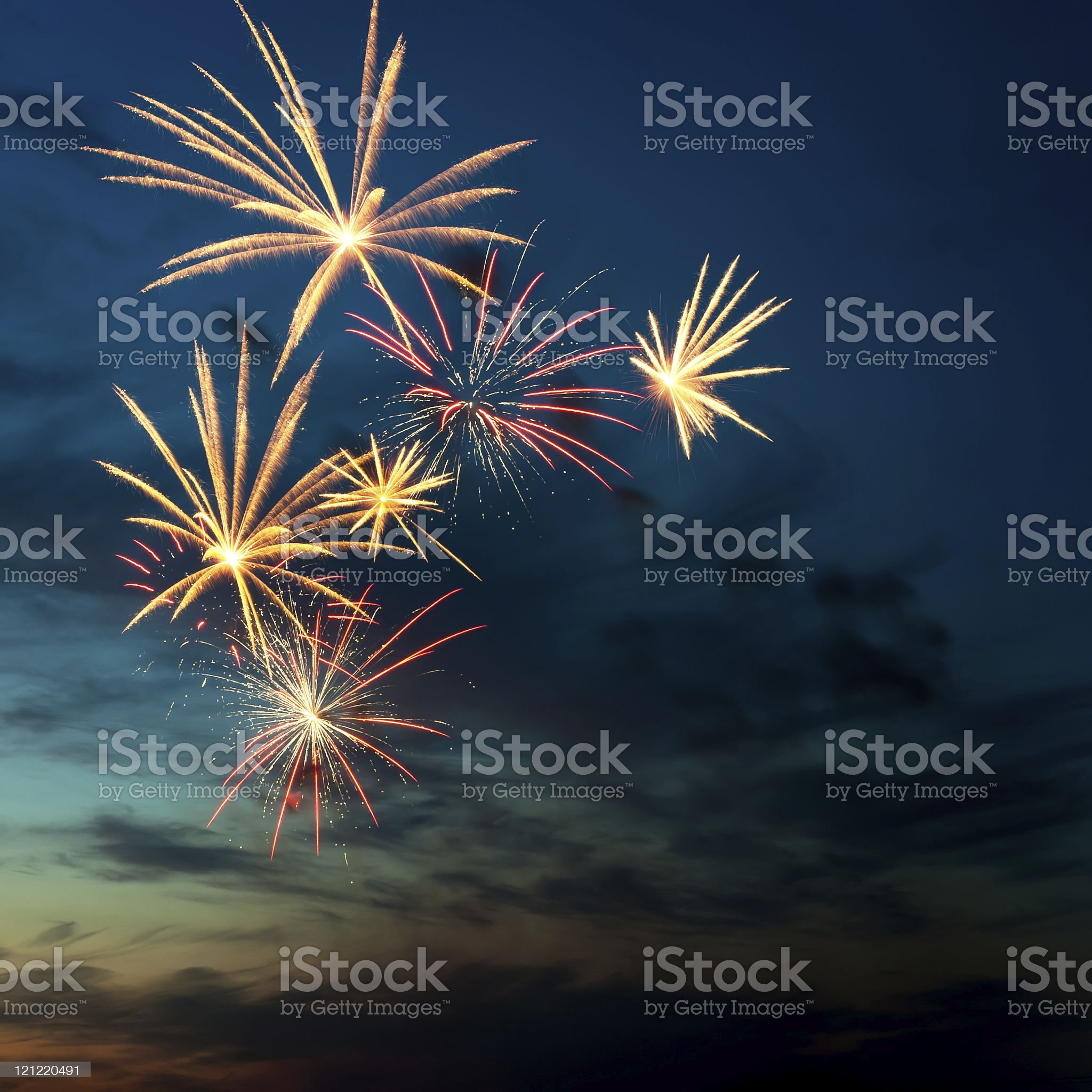 Brightly colorful fireworks  in the night sky royalty-free stock photo